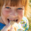 Happy girl eating ice-cream - Stock Photo