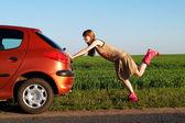 Pushing a car — Stock Photo