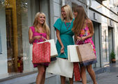 Happy girlfriends with bags — Stock Photo