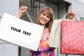 Shopping girl with blank bag for your text — Zdjęcie stockowe