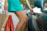 Sexy woman near car after shopping — Stock Photo