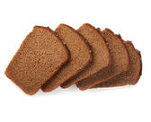 Slices of brown bread isolated — Stock Photo