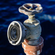 Old rusty water valve at pier — Stock Photo #10029072