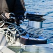 Crew work with genoa sheet rope and winch on sailing boat. — Stock Photo
