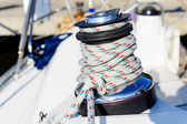 Sailing boat deck equipment: winch with halyard rope — Stock Photo