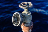 Old rusty water valve at pier — Stock Photo