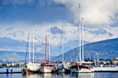 Group of big sailing vessels moored. Perfect mountain landscape — Stok fotoğraf