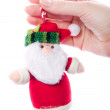 Santa toy in women&#039;s hand - Stock Photo