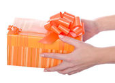 Christmas gifts in hands — Stock Photo