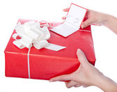 Christmas gift box in hands — Stock Photo