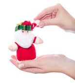 Santa toy in women's hand — Stockfoto