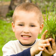 Happy children planted grass — Stock Photo