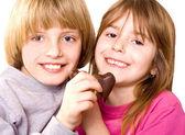 Happy children with chocolate — Stock Photo