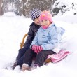 Children playing in snow — Stock Photo