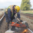 Stock Photo: Crew Cutting Railway Track