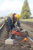Crew Cutting Railway Track — Стоковое фото