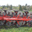 Plough in Field - Stock Photo