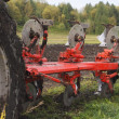 Plough on Field - Stock Photo