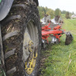 Tractor Tire and Plough — Stock Photo