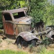 Stock Photo: Abandoned and rusted old Car