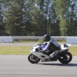 Stock Photo: Motorcyclist Reaches top speed on Track
