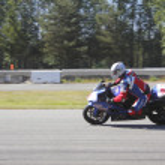 Motorcyclist Speeds around track — Stock Photo