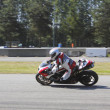 Motorcycle Racer leans in turn - Stock fotografie