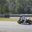 Motorcycle Racer taking bend - Foto Stock