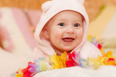 Smiling baby girl in pink — Stock Photo