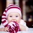 Stock Photo: Cute 6 month baby holding bobble in her hands