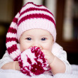Stock Photo: Cute baby in hat with pompom