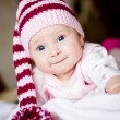 Stock Photo: Baby girl in striped hat