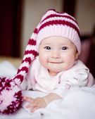 Pretty baby girl in striped hat — Stock Photo