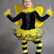 Small girl is dressed at bee costume — Stock Photo #8218828