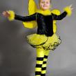 Small girl is dressed at bee costume — Stock Photo #8218838