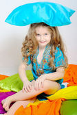 Portrait of a little girl who played with colored pillow — Stock Photo
