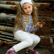 Portrait of a little girl in a landfill rusty scrap metal — Stock Photo #9340935