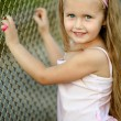 Portrait of little girl in a pink tutu — Stock Photo #9340938