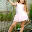 Portrait of little girl in a pink tutu — Stock Photo #9340940