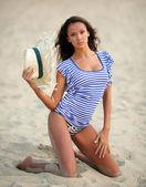 Portrait of a beautiful mulatto girl on the beach — Stock Photo