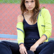 Portrait of a young girl in a tracksuit — Stock Photo #9375545
