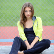 Portrait of a young girl in a tracksuit — Stock Photo #9411438