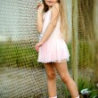Portrait of little girl in a pink tutu - Stock Photo
