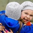 Two little girls embracing each other — Stock Photo #10153238