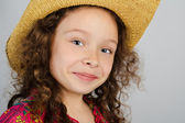 Portrait of smiling little girl in the hat — Stock fotografie