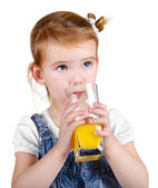 Portrait of beautiful little girl drinking a juice — Stock Photo