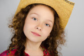 Portrait of cute little girl in hat — Stock fotografie