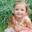 Portrait of smiling little girl in dress outdoor — Stock Photo #10520465