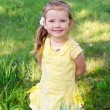 Portrait of smiling little girl in dress outdoor — Stock Photo #10535786