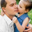 Little girl kissing her father — Stock Photo #10569398